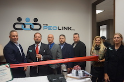 The PEO Link's New Location Ribbon Cutting Photo