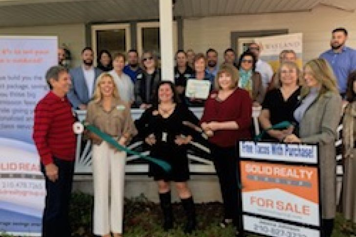 Solid Realty Group's New Location Ribbon Cutting Photo
